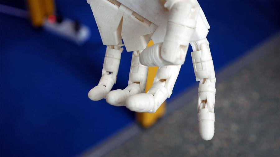 Close-up of white cyborg hand