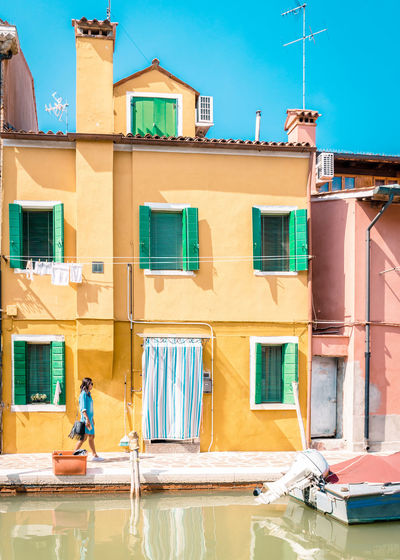 Burano, Venice Architecture Balcony Building Building Exterior Built Structure Burano Clothesline Clothing Day Drying House Men Nature Outdoors People Real People Residential District Sky Sunlight Uniform Window