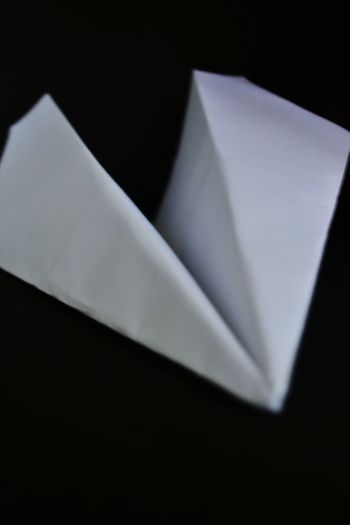 Close-up of paper against black background