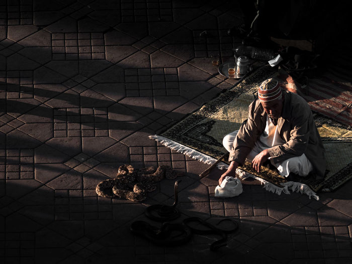 The Snake Charmer EyeEmNewHere Morocco Shadows & Lights Thinking Travel Travel Photography Full Length Marrakech Moody One Person Real People Relaxation Shadow Sitting Streetphotography Tranquil Scene The Photojournalist - 2018 EyeEm Awards The Street Photographer - 2018 EyeEm Awards The Traveler - 2018 EyeEm Awards The Portraitist - 2018 EyeEm Awards