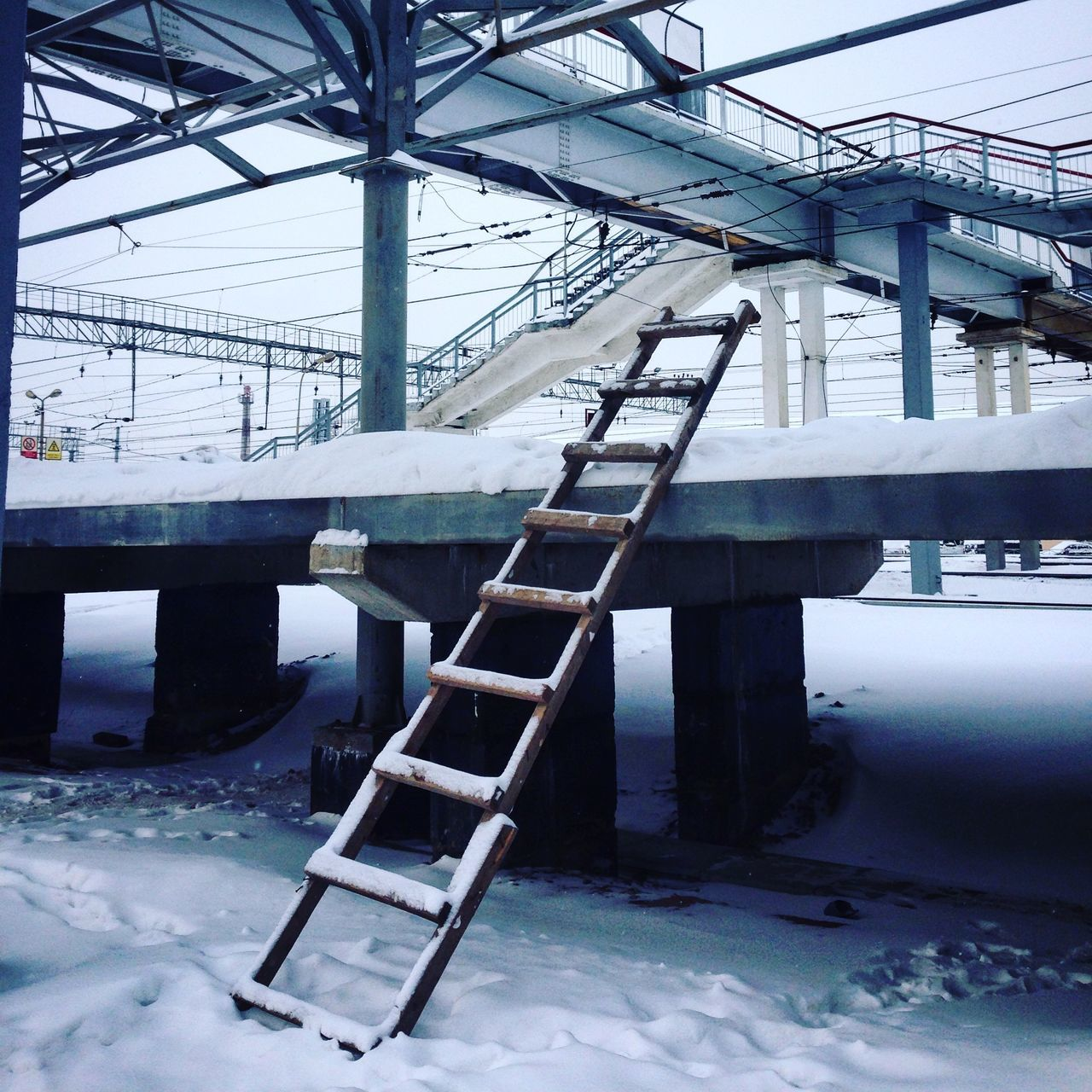 Ladder on snow covered land
