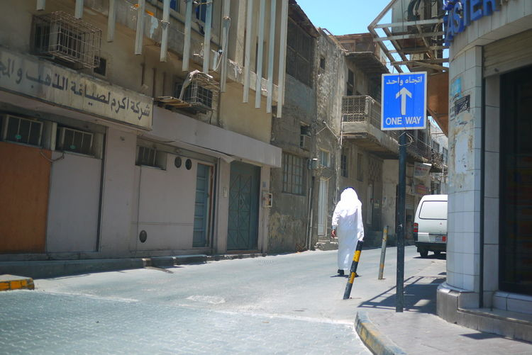 Adult Arabian Arabic Architecture City Day Egal Kandura Keffiyeh Manama One Man Only One Way Outdoors Road Road Sign Summer Walking Around The City