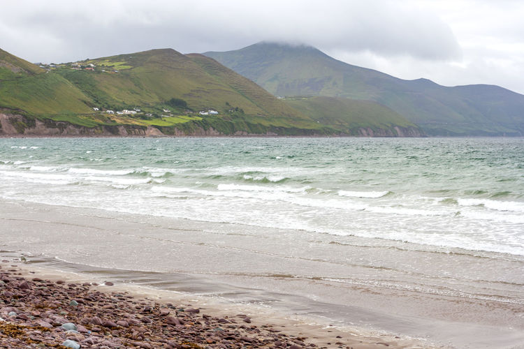 Cloudy seascape before the storm in Rossbehy, Ring of Kerry, Ireland Water Mountain Beach Land Beauty In Nature Sea Scenics - Nature Sky Tranquil Scene Tranquility Nature Day Wave No People Cloud - Sky Mountain Range Outdoors Motion Sport