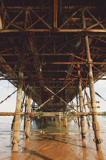 Underneath View Of Eastbourne Pier At Beach