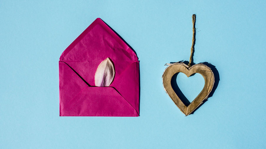 Marcweberde Heart Shape Positive Emotion Love Emotion Creativity Indoors  No People Art And Craft Still Life Blue Pink Color Close-up Studio Shot Craft Paper Copy Space Colored Background Blue Background Wall - Building Feature Wood - Material Love Letter Valentine's Day - Holiday