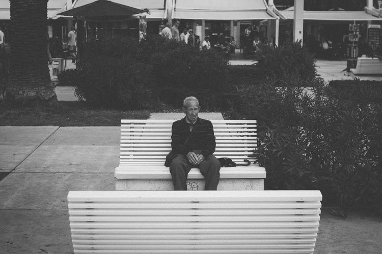 First time in many years he sits on these benches by himself Sigma 35mm Art VSCO Blackandwhite Eye Em Best Shots -Black +White EyeEmBestPics EyeEm Selects EyeEm Gallery EyeEm Best Shots Croatia Split Sitting One Person Outdoors Real People Relaxation Day Lifestyles One Man Only