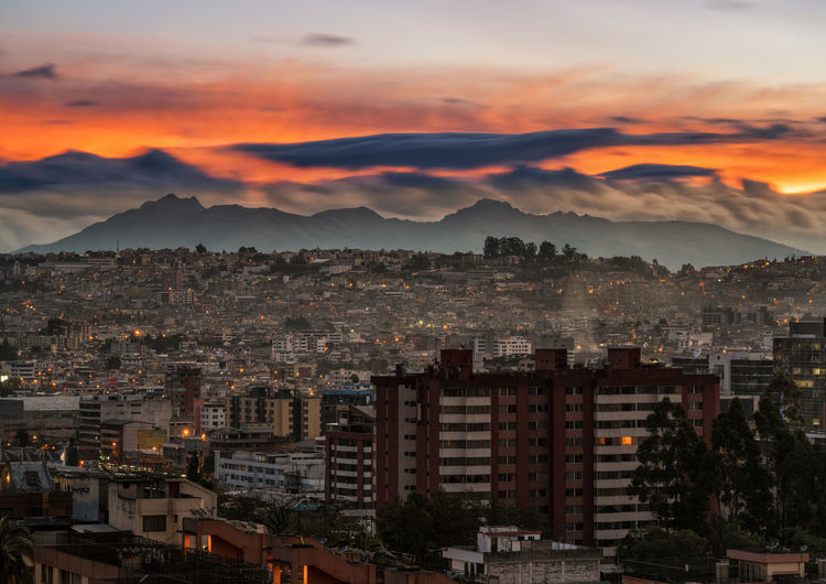 Quito cityscape just before sunrise Quito Architecture Outdoors Built Structure Ecuador Travel Destinations Mountain Quito City Cityscape Cloud - Sky No People City South America Building Exterior This Is Latin America
