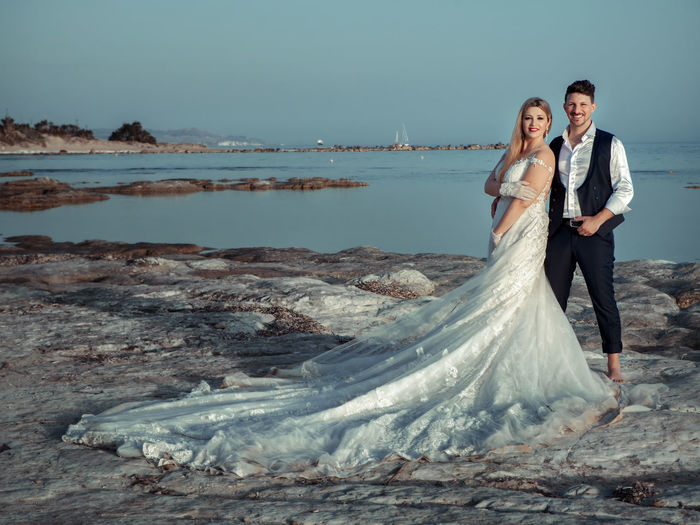 Adult Beach Couple - Relationship Emotion Full Length Men Nature Newlywed Positive Emotion Real People Sea Togetherness Two People Water Wedding Wedding Dress Women Young Adult Young Men Young Women