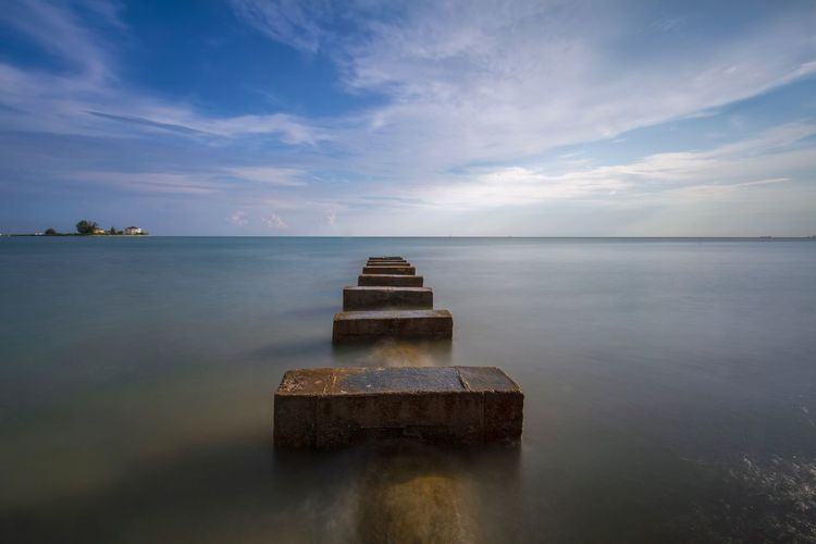 Clouds And Sky Eye Em Nature Lover Malaysia Scenery Malaysia Kuala Lumpur Malaysia  Water Sky Cloud - Sky Sea Tranquility No People Tranquil Scene Scenics - Nature Nature Beauty In Nature Horizon Horizon Over Water Reflection Outdoors Land Beach Long Exposure Day