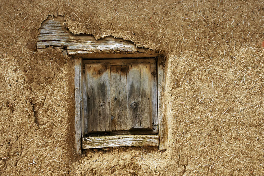 wooden window in adobe house Architecture Built Structure Close-up Closed Day Deterioration Full Frame No People Old Outdoors Wall Wood - Material Wooden