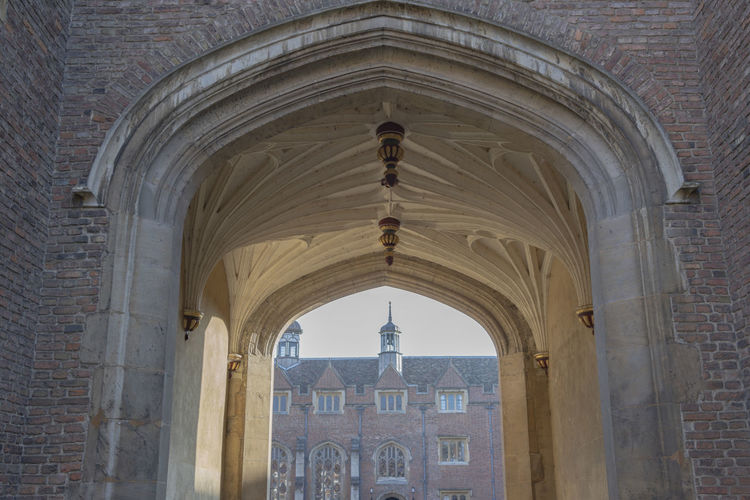 Architecture Built Structure Arch Building Building Exterior Day History The Past No People Old Travel Destinations Arched Entrance Architectural Column Colonnade Stone Material Stone Wall Brick Wall Cambridge England Courtyard  Looking Through Low Angle View College Campus