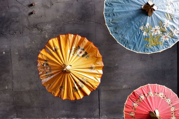 High angle view of umbrella on wooden table