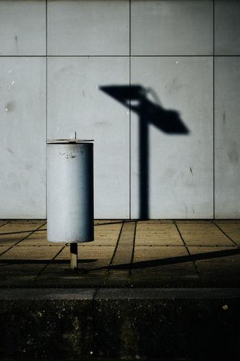 Shadow on wall by footpath