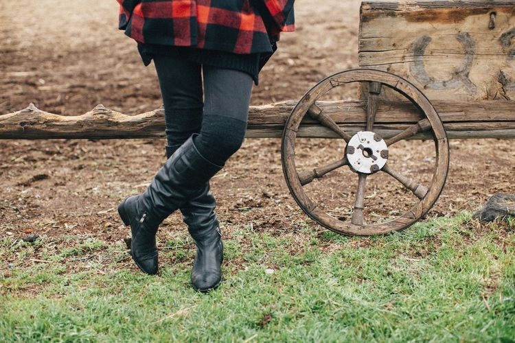 Boots Casual Clothing Close-up Day Grass Grassy Green Color Leisure Activity Nature Outdoors Wheel Wooden Wooden Wheel