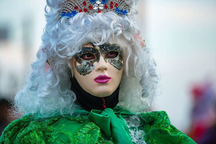 Carnival Carnival In Venice Venice, Italy Adult Adults Only Arts Culture And Entertainment Carnival - Celebration Event Carnival Clothing Carnival Masks Close-up Costume Day Disguise Fashion Feather  Front View Green Color Headwear Mask - Disguise One Person Outdoors People Tradition Venetian Mask