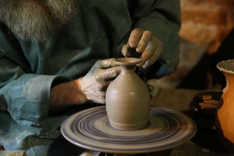 hands shaping a clay pot Abruzzese Abruzzo - Italy Art And Craft Clay Craft Craftsperson Creativity Expertise Hand Human Hand Indoors  Making Molding A Shape Motion Mud Natale  Occupation One Person Pottery Preparation  Sculptor Skill  Spinning Working Workshop