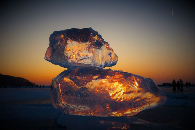 Close-up of ice against sky during sunset