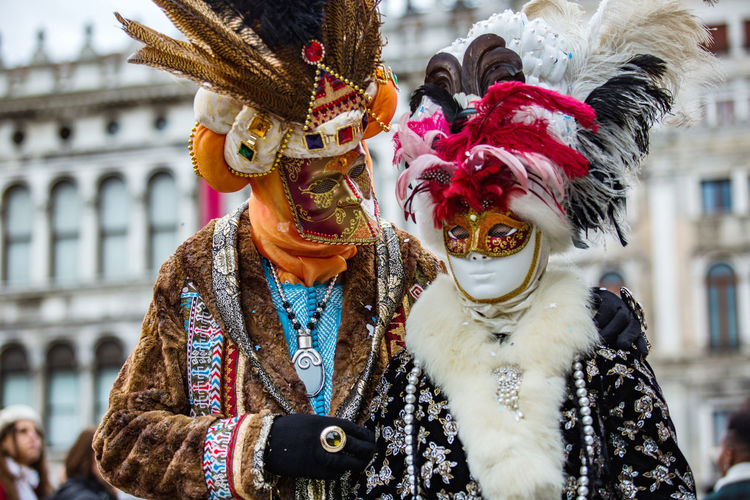 Carnival Carnival In Venice Architecture Arts Culture And Entertainment Carnival Masks Celebration Costume Cultures Day Focus On Foreground Leisure Activity Lifestyles Mask - Disguise Outdoors People Real People Tradition Traditional Clothing Two People Venetian Mask Venice