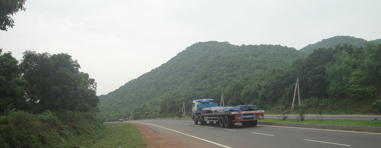 High Way View Hills Tree Beauty In Nature Day High Way Land Vehicle Mode Of Transport Mountain Nature No People Outdoors Road Scenics Sky The Way Forward Transportation Travel Destinations Tree Trucks
