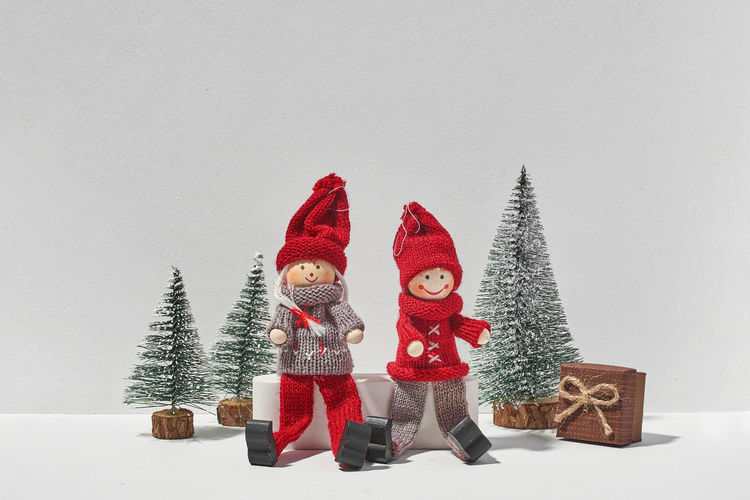 Christmas decorations on snow against white background