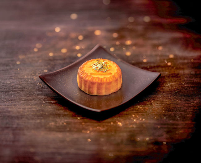 Close-up of moon cake in plate on table