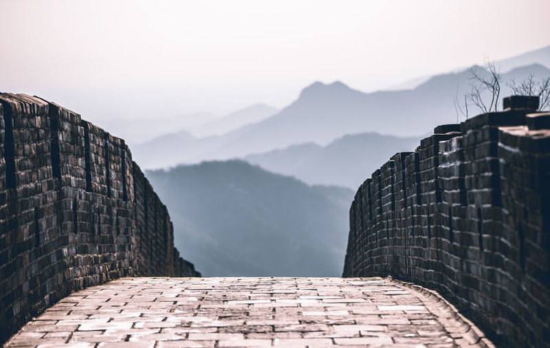 View of brick wall against mountain range