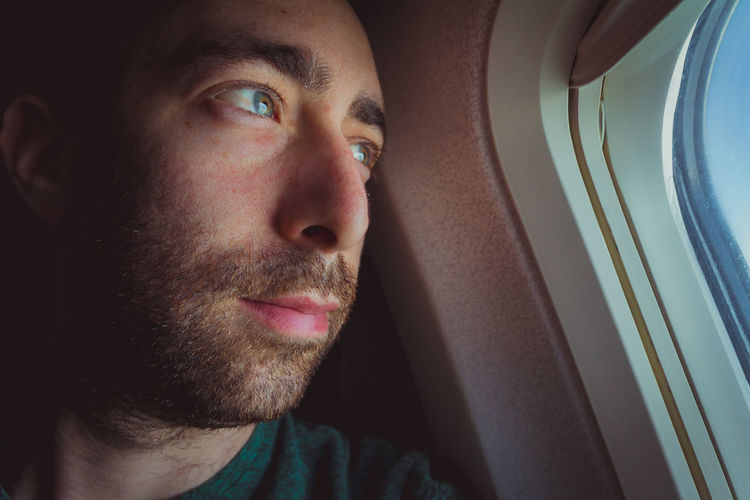 Plane Window Man Airplane Looking Out Travel Passenger person Thinking Jet People Face Flight Adult Caucasian Male One Pensive Outside Thoughtful Traveler Traveller Vacation View HEAD Guy Transport Sitting Transportation Interior Cabin Young Journey Flying Through Trip Alone Inside Confident  Expression Low Angle Emotional Expressionless Dark Dramatic Closeup Close Up Smile Israeli