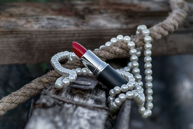 Stay sassy and classy! The Creative - 2019 EyeEm Awards Necklace Rusty Beauty CreativePhotographer Creativity Creative Photography Focus On Foreground Lipstick Makeup Make-up Moody Pearls Necklace Jewelry Red Lipstick Red Lips Wood - Material Close-up Bead Pearl Jewelry