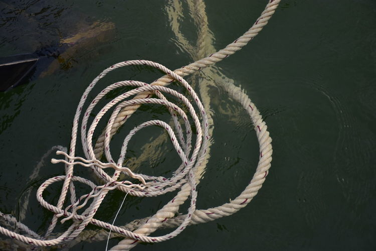 High angle view of rope in water