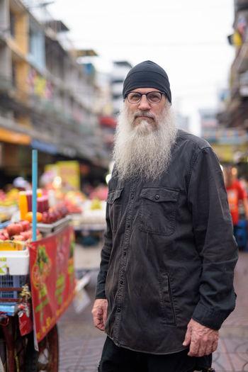 Man standing on street market in city