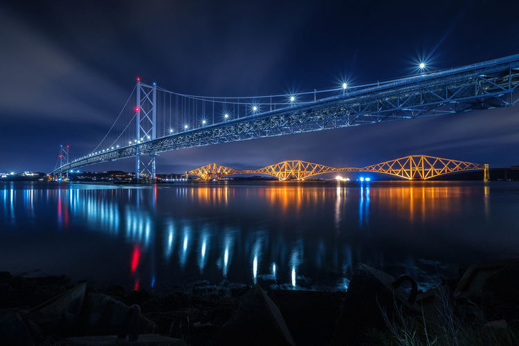 Water Built Structure Illuminated Transportation Architecture Night Bridge - Man Made Structure Connection Bridge Travel Destinations Sky Reflection Suspension Bridge Engineering River Nature Travel Tourism Outdoors Bay Nightlife Scotland Forth Bridge Nightphotography