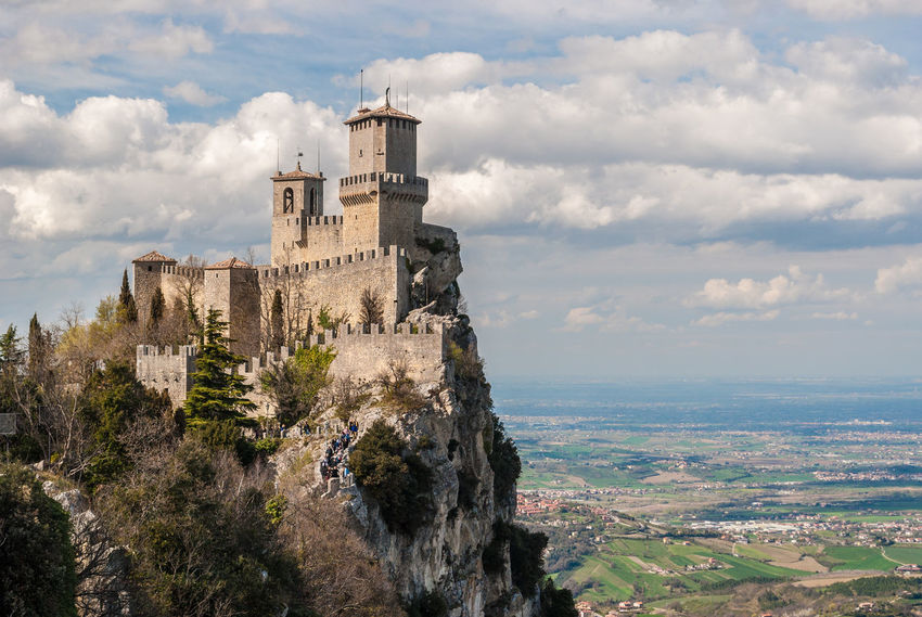 The fortress of Guaita in San Marino; plains of Romagna in the background Ancient Architecture Building Exterior Castle Castle Cliff Cloud - Sky Clouds Day Fortification Fortress Guaita History Italy Landmark Landscape Outdoors Panoramic San Marino Scenics Sky Sky And Clouds Stronghold Tower Travel