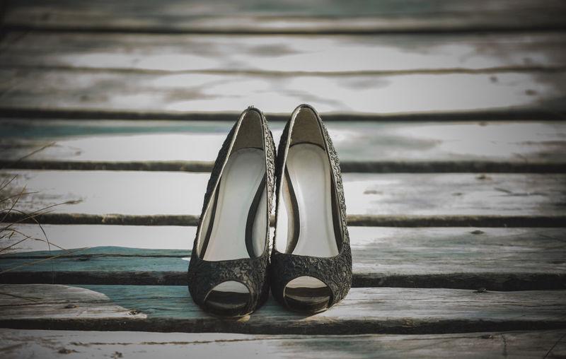 Close-Up Of Sandal On Boardwalk