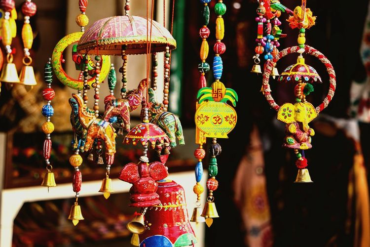 Close-up of decorations hanging for sale at market