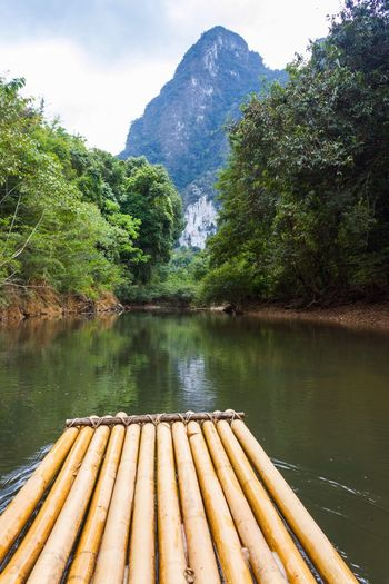 Boat on the river Boat Water Mountain Bamboo - Material Nature Wooden Raft Outdoors Day Tree Beauty In Nature Tropical Jungle Rainforest Krabi Thailand Suratthani Wild Lost In The Landscape Be. Ready.