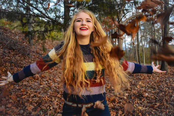 Autumn Long Hair Leaf Smiling Forest Happiness Cold Temperature One Person Tree Nature Beauty Young Adult Outdoors Young Women Leisure Activity Blond Hair Fun People Cheerful Standing