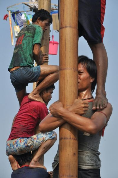 Areca nut tree climbing competition or panjat pinang is one of activities of the Indonesian people to celebrate independence day on August 17 Lomba Panjat Pinang Panjat Pinang Pohon Pinang Independence Day Indonesia Independen Day 17 Agustus 17 Agustus 1945 Kemerdekaan RI People