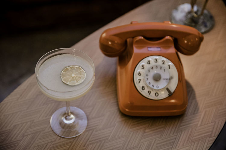 High angle view of telephone on table