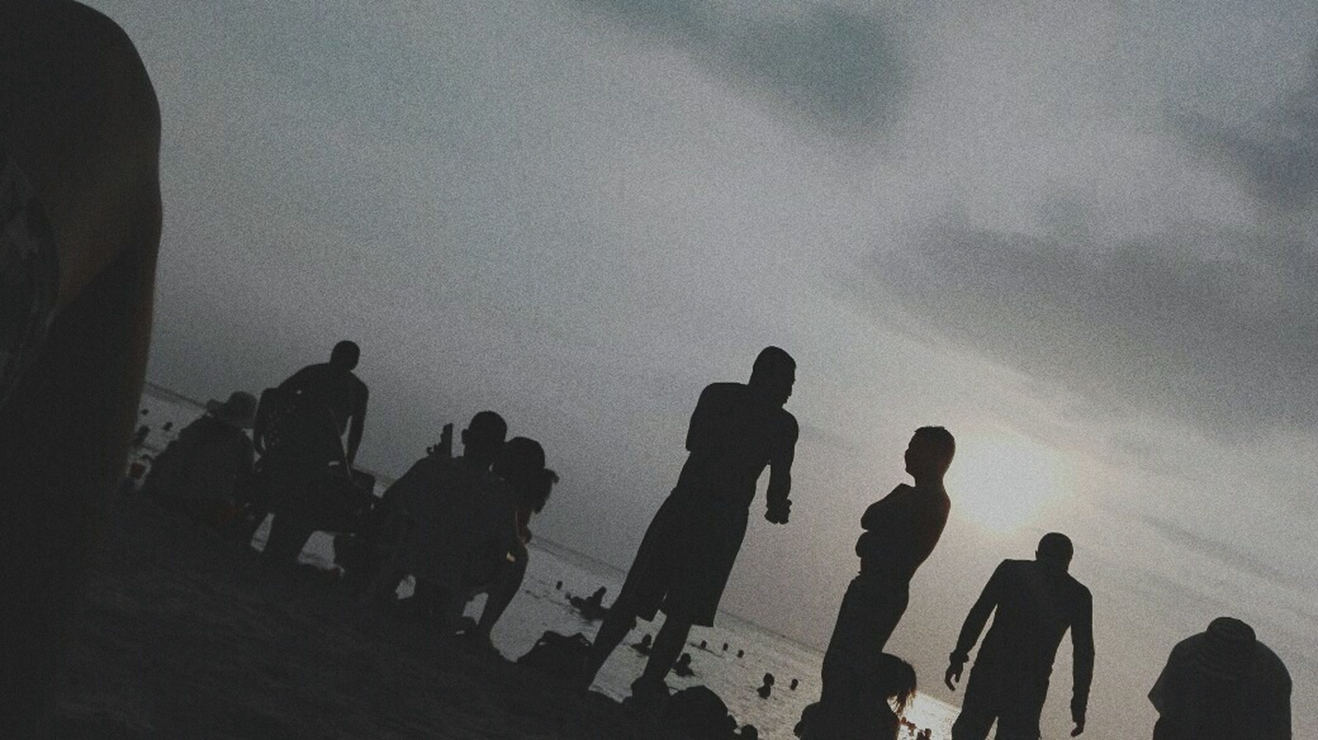 silhouette, large group of people, sky, full length, men, people, togetherness, real people, teamwork, adults only, outdoors, night, only men, adult, astronomy