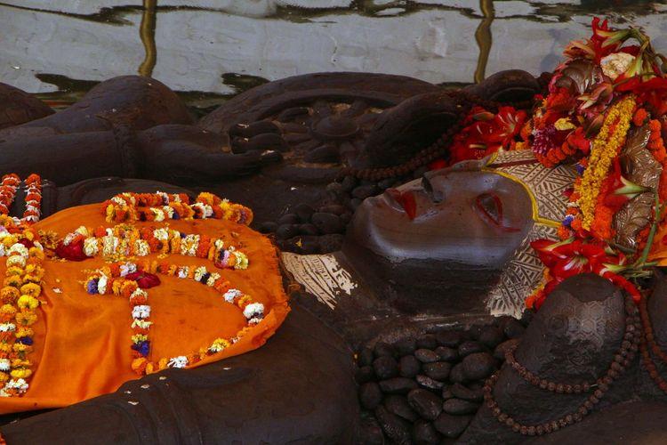 Lord bishnu statue in Budhanilakantha Art Art And Craft Bishnu Budhanilakantha Creativity Cultures Day High Angle View Lifestyles Lord Bishnu Men Nepal Outdoors Red Religion Sculpture Statue Tradition Water