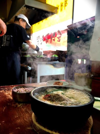 Food And Drink Food Preparation  Indoors  Restaurant Preparing Food Men Chef Real People Freshness Kitchen Commercial Kitchen Steam Occupation Uniform Gourmet One Man Only One Person Food And Drink Establishment Only Men Daily Life Day Korean Food Korean Soup