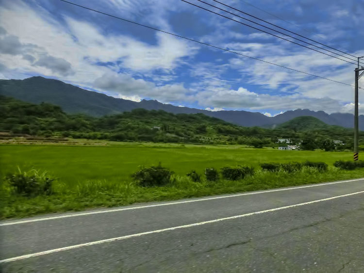 Beauty In Nature Blue Cloud - Sky Day Grass Green Color Landscape Mountain Nature No People Outdoors Road Scenics Sky Tree
