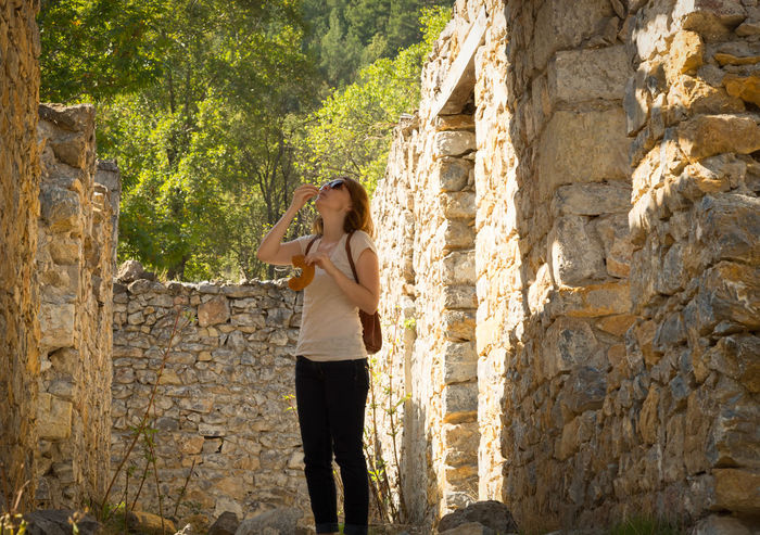 Woman in Ruins Autumn Autumn Colors Backpacking Belemedik Between Buildings Between Nature Eating Exploring Fall Fashion Greenery Hikingadventures Landscape Leisure Activity Pozanti Ruins Architecture Solitude Standing Stone Stone Material Turkey Woman Pointing On Trabi Woman Portrait