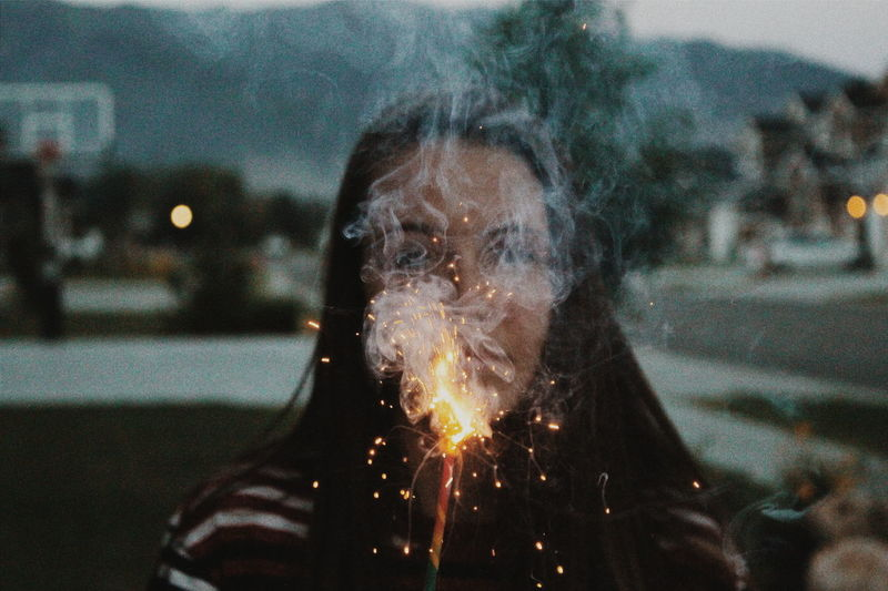 View of girl with sparkler