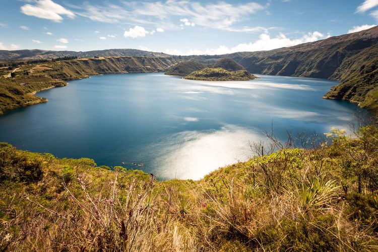 Andes Imbabura Beauty In Nature Cloud - Sky Cuicocha Day High Angle View Idyllic Island Lake Landscape Mountain Nature No People Non-urban Scene Outdoors Physical Geography Scenics Sky Sunlight Tranquil Scene Tranquility Travel Destinations Volcanic Lake Water This Is Latin America