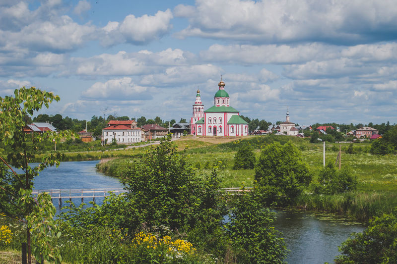 Landscape in Suzdal Built Structure Architecture Water Cloud - Sky Building Exterior Building Plant Sky Religion Nature Tree River Place Of Worship Belief Day Travel No People Spirituality Waterfront Outdoors Russia Orthodox Orthodox Church Summer Suzdal