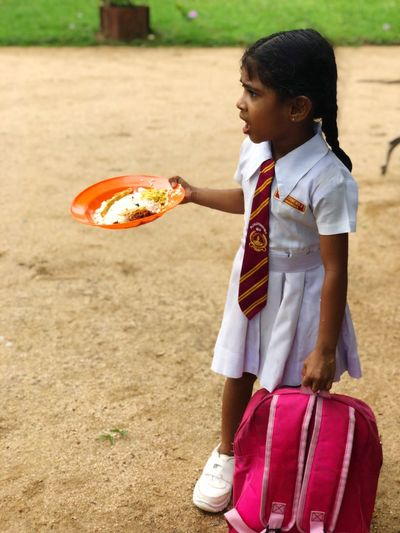 Lunch Food School Sri Lanka SriLanka Girl Kid EyeEm Selects Childhood One Person Child Real People Girls Day Standing Lifestyles Holding Females Outdoors Innocence
