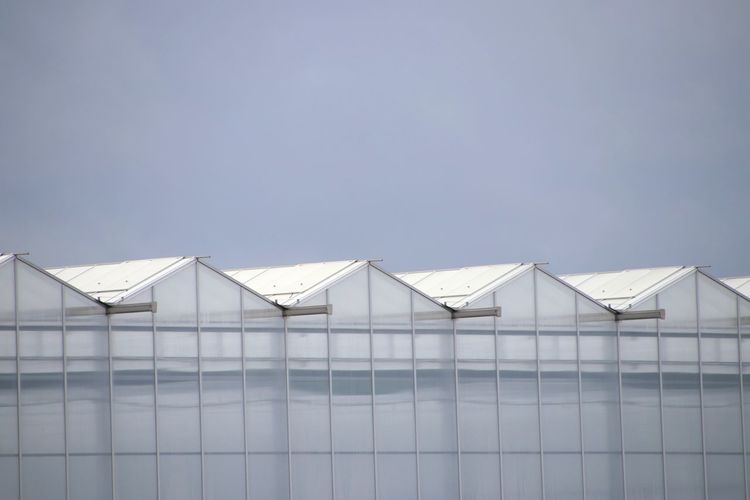 Greenhouse against clear sky