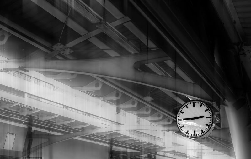 Low angle view of clock hanging on ceiling at railroad station