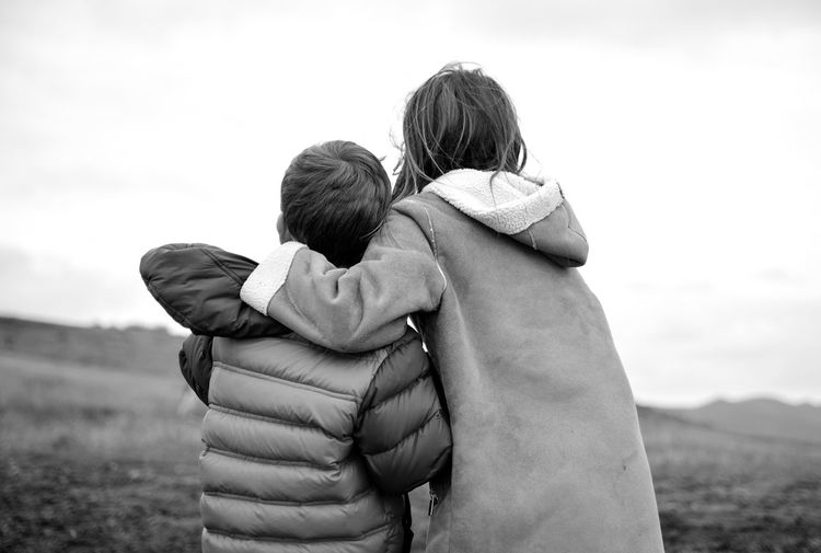 Sibling bond From Behind Touch Nurturing Childhoold Brother And Sister Sweet Moments Wonder Joy Happiness Love Wild And Free Brother And Sister Sibling Love Sibling Bond Two People Women Togetherness Child Real People Love Adult Family Bonding Rear View Childhood Lifestyles Emotion People